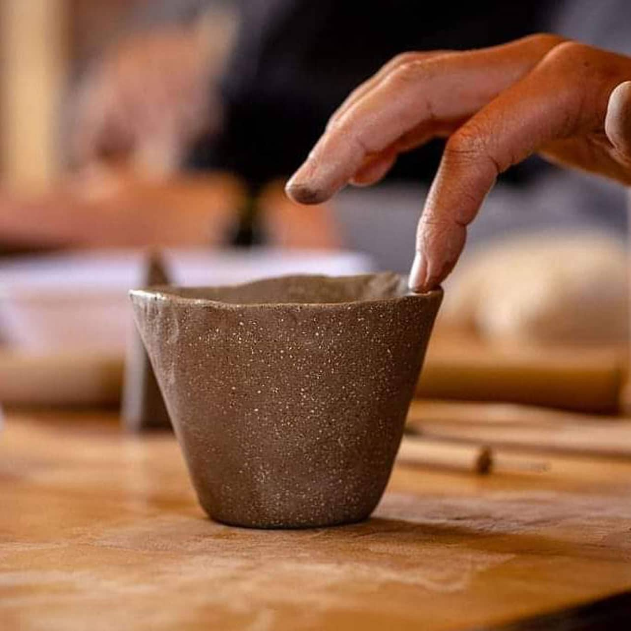 finger and small pot